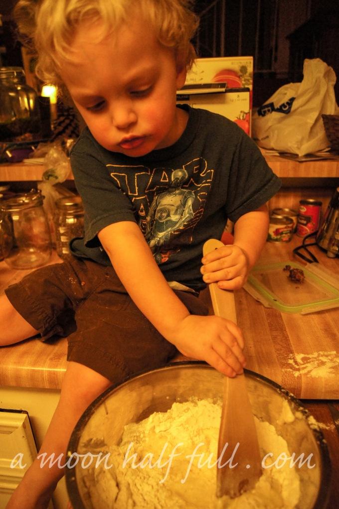 Helping Mama make pancakes