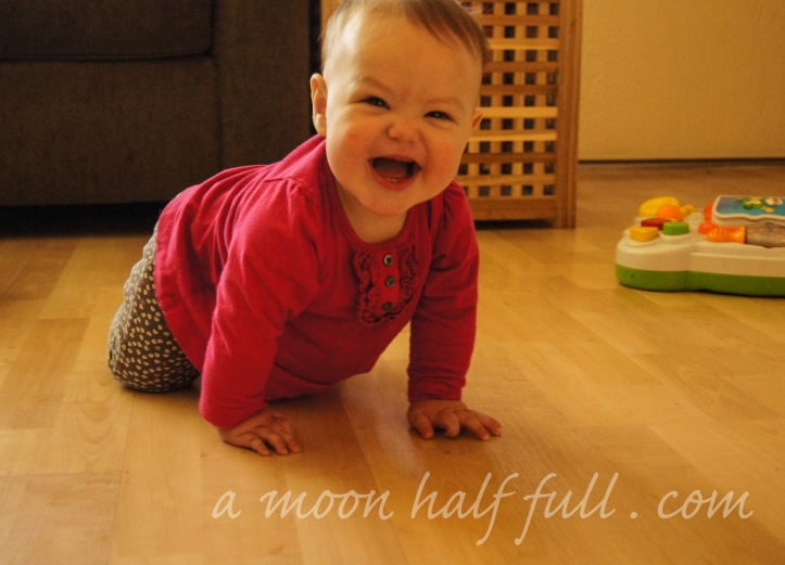 This girl can crawl and she is very proud.